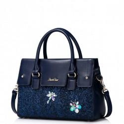Dziewczęca torebka do ręki z połyskującymi dekoracjami Niebieska